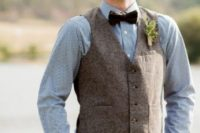 10 a blue printed button down, tweed vest, brown dress pants, and dark bow tie for a vintage and rustic look