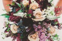 10 a bold and lush bridal bouquet with deep purple, burgundy and fuchsia blooms