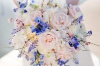 10 a pastel bouquet with bold touches of blue Muscari, blue delphinium, pink genestra and blushing roses
