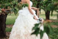 10 a refined strapless wedding dress with a full ruffled blush ombre skirt