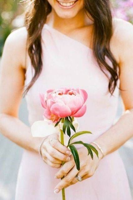 a single large pink peony for a bridesmaid's bouquet