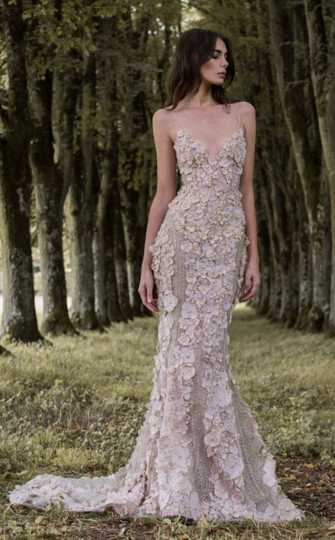 a spaghetti strap mermaid silhouette floral applique wedding dress in blush looks wow