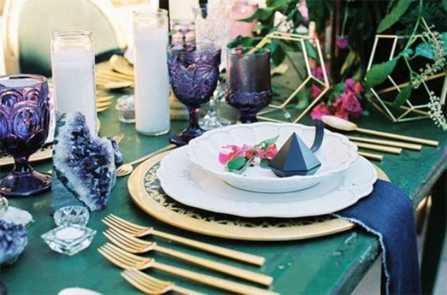 amethysts and purple glass that match to create a trendy and bold tablescape