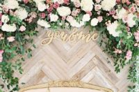 10 chevron-clad wooden backdrop with lush blooms and foliage for a chic look