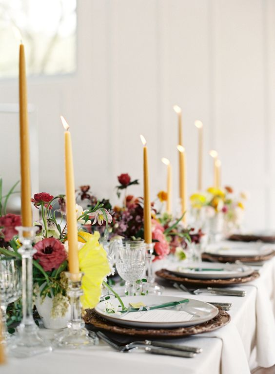 yellow candles and moody florals plus refined chargers make this spring table settign moody