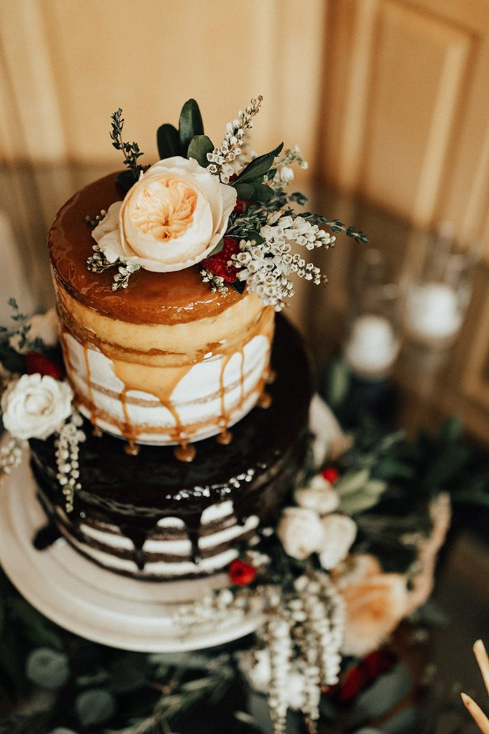 The wedding cake was a naked one, with caramel and chocolate dripping and fresh blooms