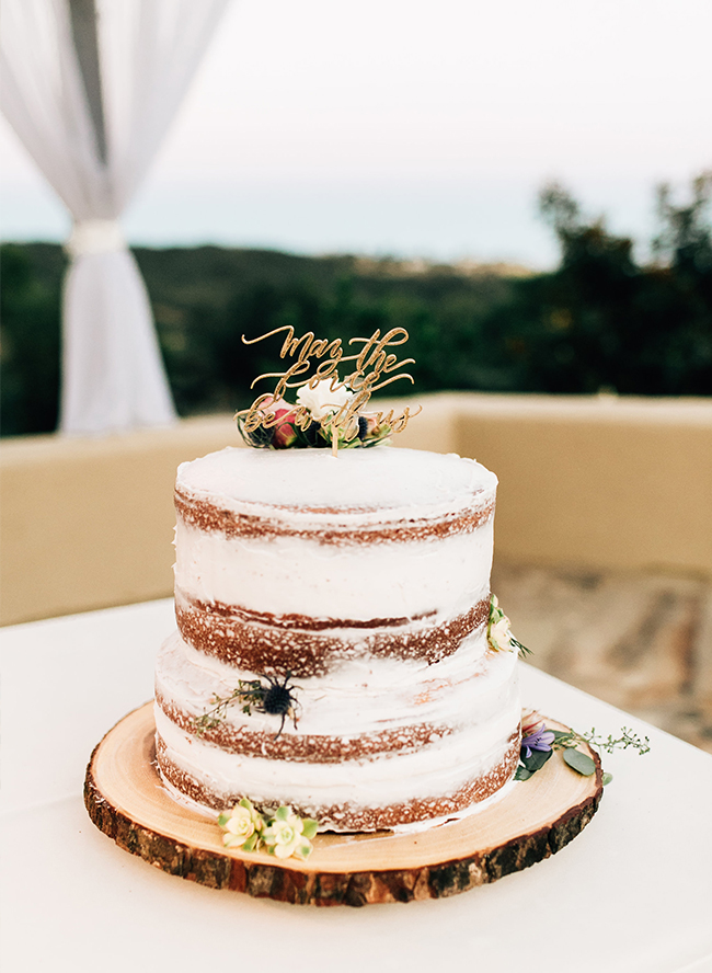 The wedding cake was a naked one with some blooms and a calligraphy topper