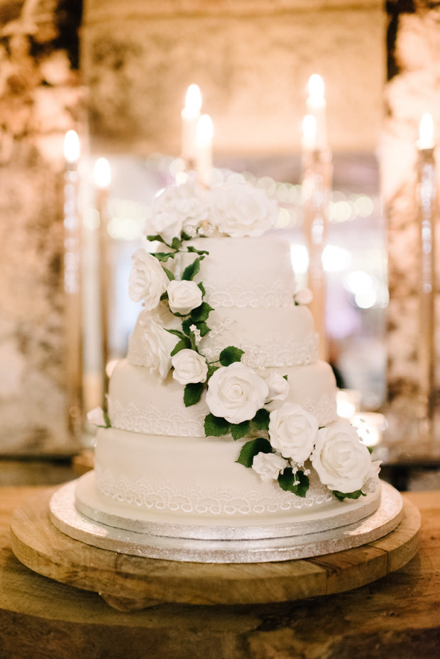 The wedding cake was an elegant neutral one with white blooms and foliage