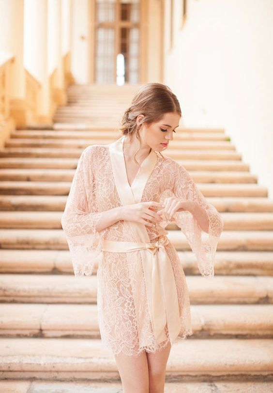 a sheer off-white lace short bridal robe with bell sleeves and a silk ribbon edge plus the same sash