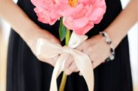 11 a single pink bloom with a neutral ribbon bow is a chic idea for a black and pink wedding