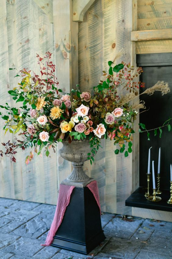 a statement moody floral decoration with dusty and yellow blooms
