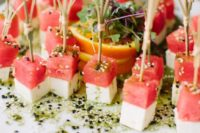 11 cheese and watermelon skewers with sesame seeds are a fresh and tasty idea to try for spring and summer