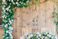 11 old barn doors decorated with lush blooms and foliage look cute and rustic