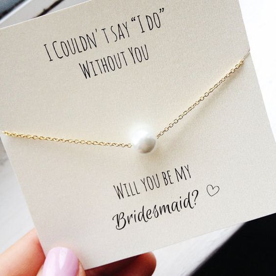 stylish question popping with a pearl necklace to wear on the big day
