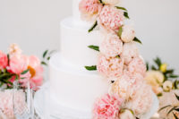12 The wedding cake was decorated with fresh blooms in pink shades