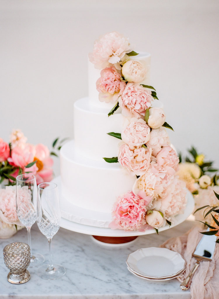 The wedding cake was decorated with fresh blooms in pink shades