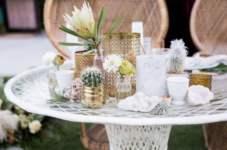 The wedding tables were styled with cacti, proteas, blooms and candles