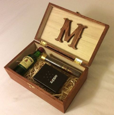 a small box with a cigar, a little alcohol bottle, a lighter - just add a tag and voila