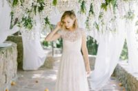 12 gorgeous hanging blooms, fabric and a crystal chandelier for a beautiful wedding ceremony space