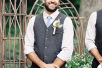12 navy pants, a white shirt, a powder blue tie and a grey waistcoat with a large boutonniere