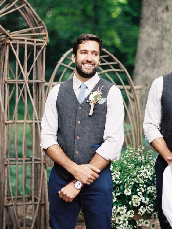 navy pants, a white shirt, a powder blue tie and a grey waistcoat with a large boutonniere