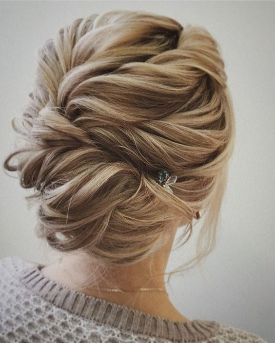 twisted braided updo with a cool texture and a small hairpiece on the side