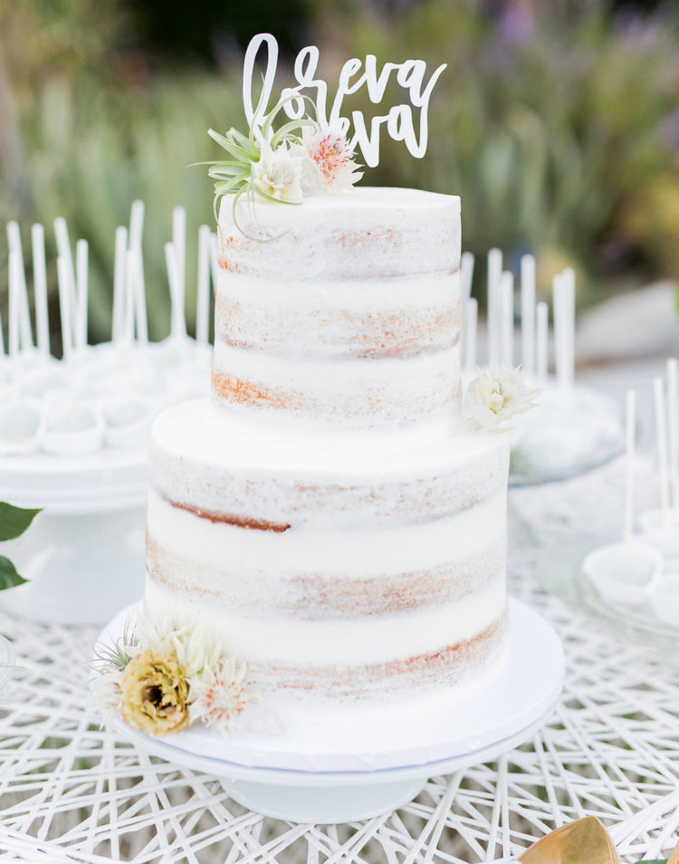 The wedding cake was a naked one with florals and a calligraphy topper