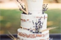13 a lovely naked wedding cake with wheat and lavender looks cute and rustic