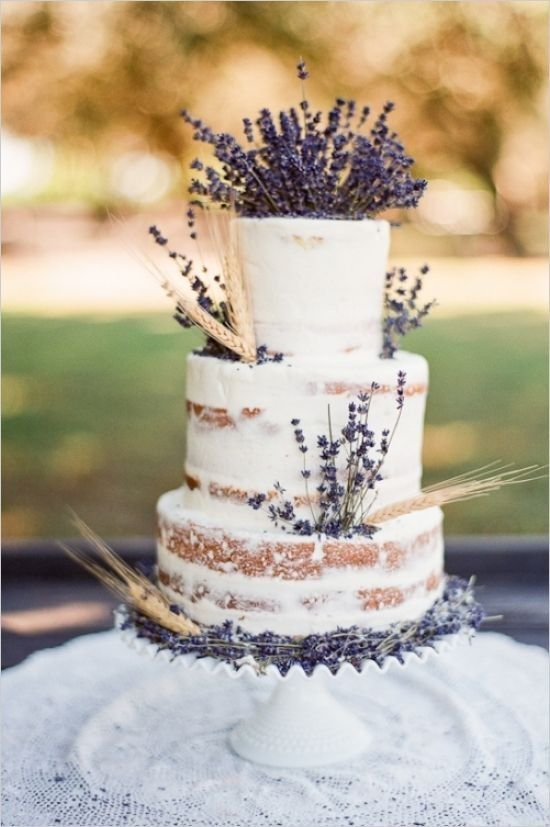 a lovely naked wedding cake with wheat and lavender looks cute and rustic