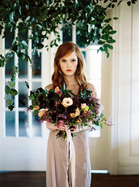 a moody wedding bouquet in the shaddes of purple and lilac plus dark burgundy