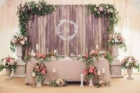 13 a wooden backdrop with lush foliage and blooms for an elegant vintage look