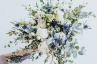 13 an ethereal bouquet with eucalyptus, blue thistles, white roses and herbs looks very beautiful