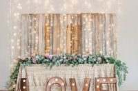 14 a cool reclaimed wood backdrop with lots of lights hanging from above