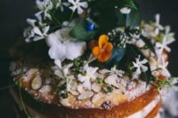 14 a naked cake topped with almonds, fresh blooms and foliage for a moody spring wedding