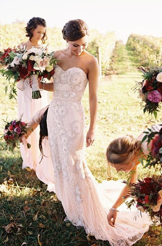 strapless sheath floral applique wedding dress in pink shade with heavy embellishments and a train