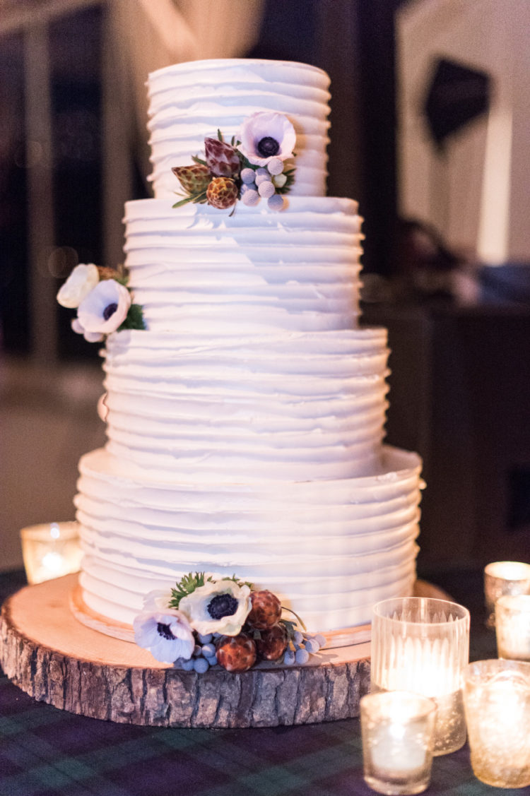 The wedding cake was a textured white one topped with fresh blooms
