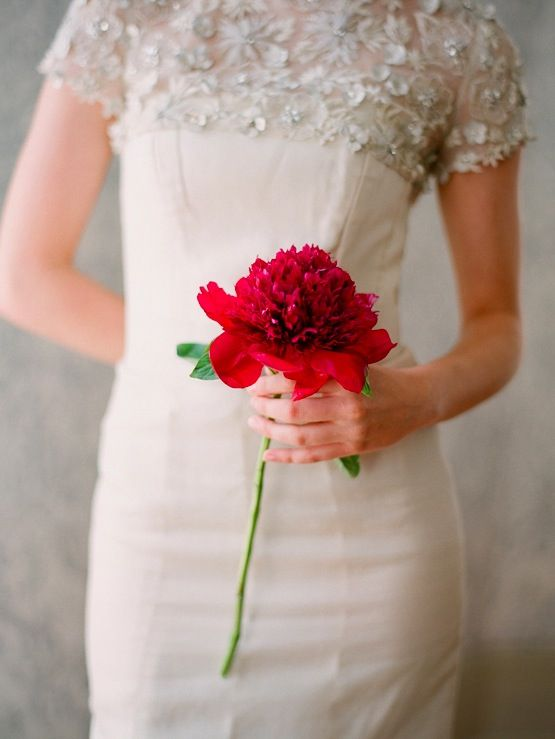a single red bloom to stand out with a neutral wedding gown