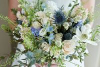 15 a textural wedding bouquet with blue thistles, white blooms, various greenery looks natural and a bit wild