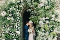 15 chapel entry decorated with kush greenery and white blooms