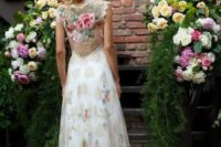 16 a bold floral wedding dress without sleeves and with an illusion floral back