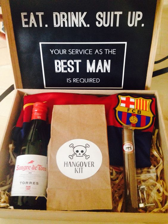 a box with a hangover kit, a cigar, a bottle of alcohol, a football fan scarf for a best man proposal