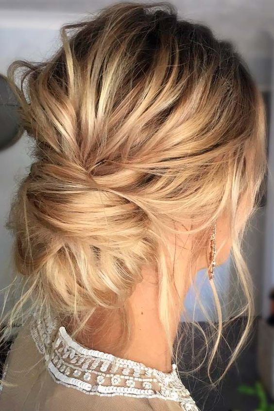 a very messy updo with a low bun and locks down for a casual and effortlessly chic look