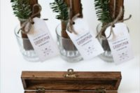 16 a wooden box with a little pinecone and a cigar for a stylish winter wedding