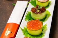 16 cucumber wrapped sushi topped with salmon roe, yellowtail, tuna, and sweet shrimp