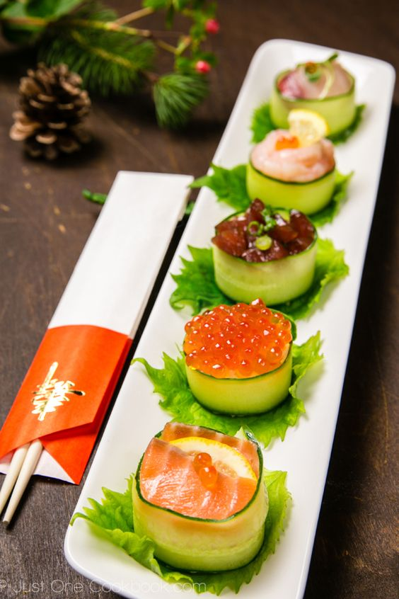 cucumber wrapped sushi topped with salmon roe, yellowtail, tuna, and sweet shrimp