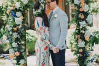 17 a colorful floral print boho wedding dress with long sleeves and embroidery for a free-spirited bride