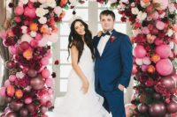 17 a lush ombre balloon and floral wedding arch is a cool and glam idea