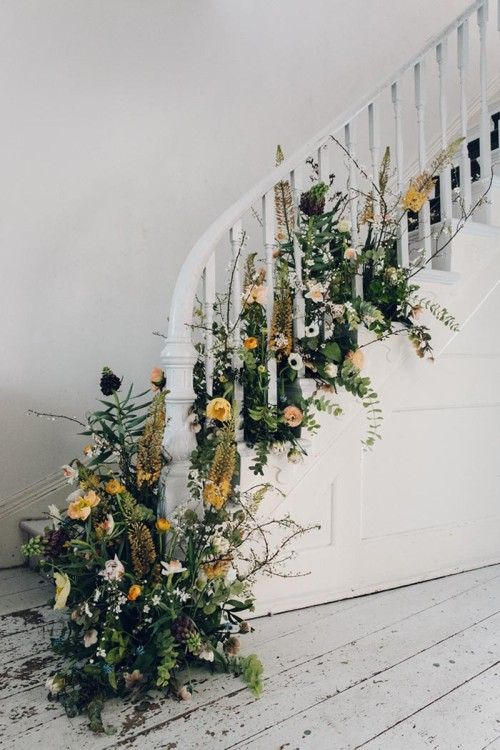 moody florals and herbs for decorating a staircase