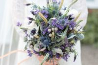 17 wheat, purple lavender, white anemones, blue thistles and various greenery for a colorful statement