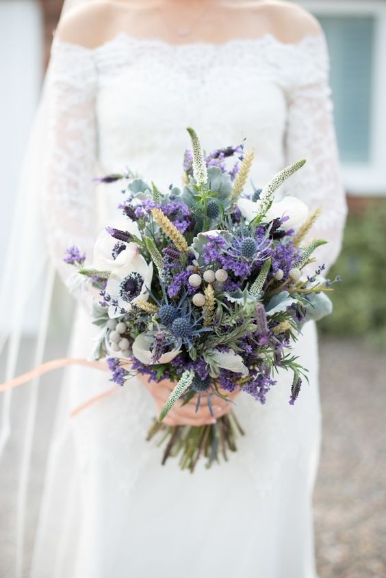 wheat, purple lavender, white anemones, blue thistles and various greenery for a colorful statement